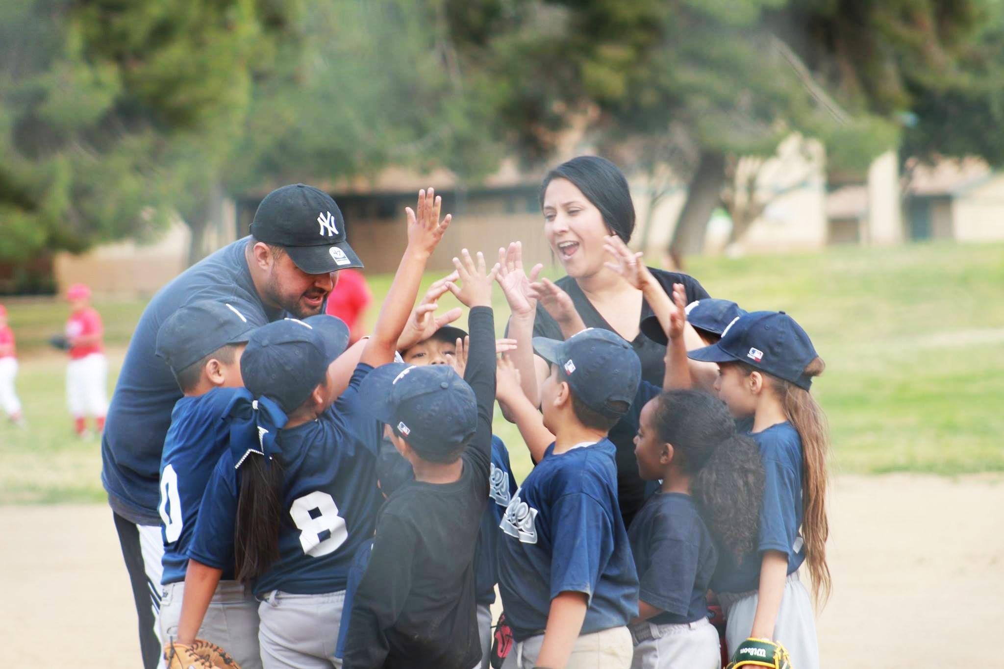 Youth Baseball huddle Team cheering