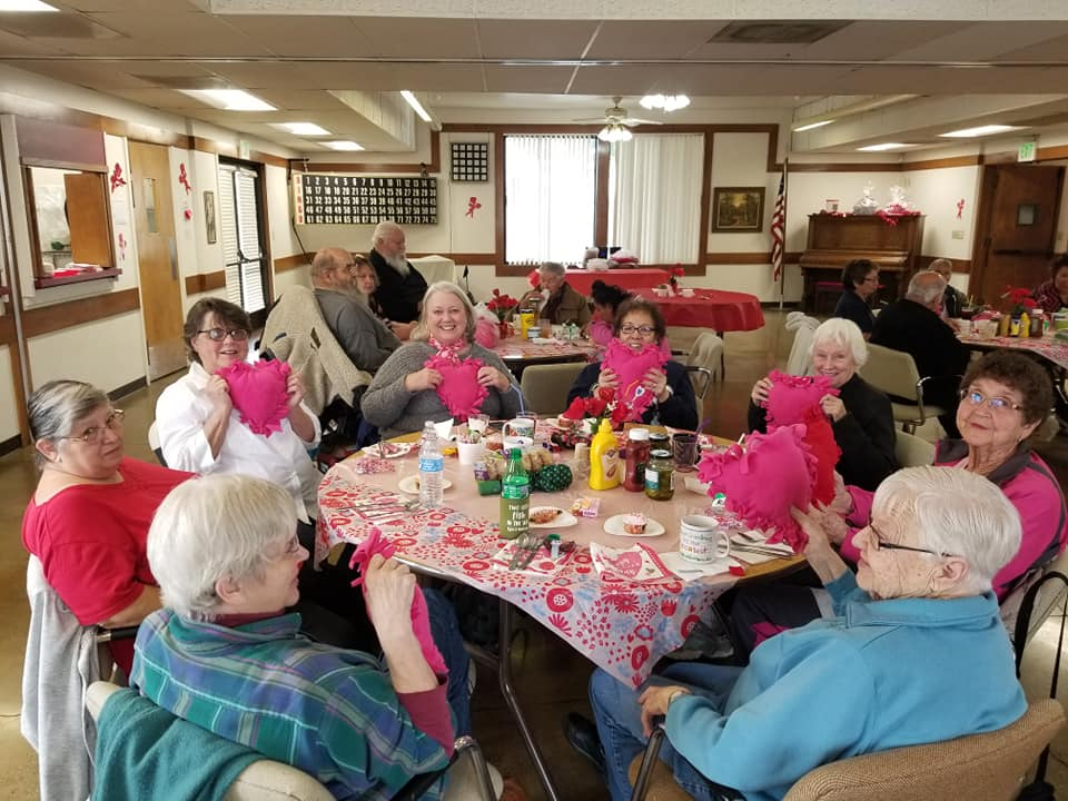 Women doing valentiines day craft